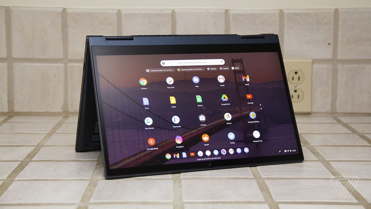 The ThinkPad C13 Yoga Chromebook in tent mode. The screen displays a grid of Android apps.