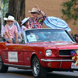 Elder Ronald A. Rasband, a member of the Quorum of the Twelve Apostles of The Church of Jesus Christ of Latter-day Saints, waves during the Days of '47 Parade in Salt Lake City on Friday, July 23, 2021. Elder Rasband was this year's grand marshal.
