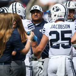 Brigham Young Cougars head coach Kalani Sitake looks up at the scoreboard during a time out late in the first half, trailing 17-3 against the Wisconsin Badgers, at LaVell Edwards Stadium in Provo on Saturday, Sept. 16, 2017.
