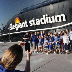 BYU fans take photos outside the Allegiant Stadium prior to the Vegas Kickoff Classic between BYU and Arizona in Las Vegas on Saturday, Sept. 4, 2021.