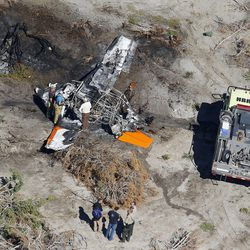 Emergency crews respond to a plane crash in an area east of Eureka, Utah, Saturday, Oct. 24, 2015.