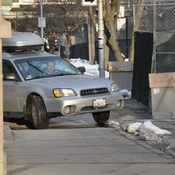 Car pulling up to the Waveland sidewalk at Kenmore -