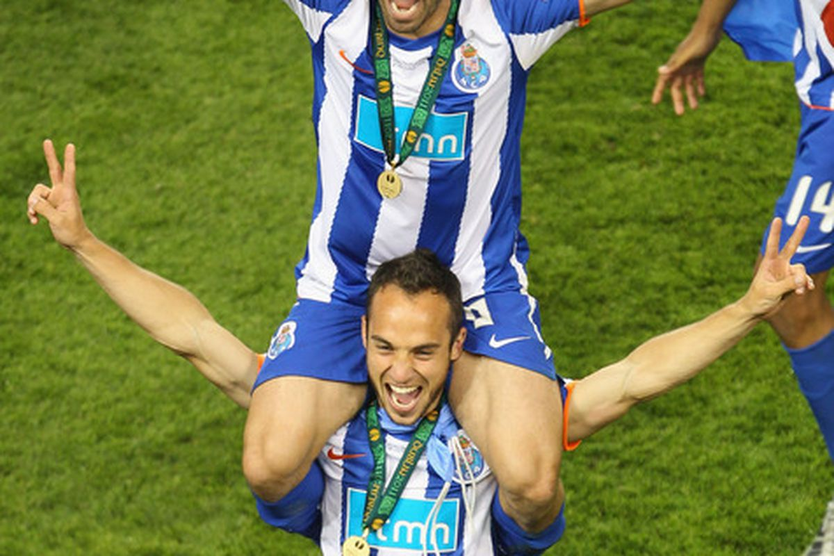 DUBLIN, IRELAND - MAY 18:  Fernando Belluschi  and Joao Moutinho celebrate victory during the UEFA Europa League Final between FC Porto and SC Braga at Dublin Arena on May 18, 2011 in Dublin, Ireland.  (Photo by Julian Finney/Getty Images)
