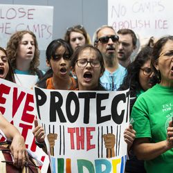 Rosio Almazan, of the Brighton Park Neighborhood Council, joins dozens of other immigrant rights activists to protest outside the Marriott Marquis Chicago on Tuesday while U.S. Customs and Border Protection hosts the 2019 Trade Symposium.