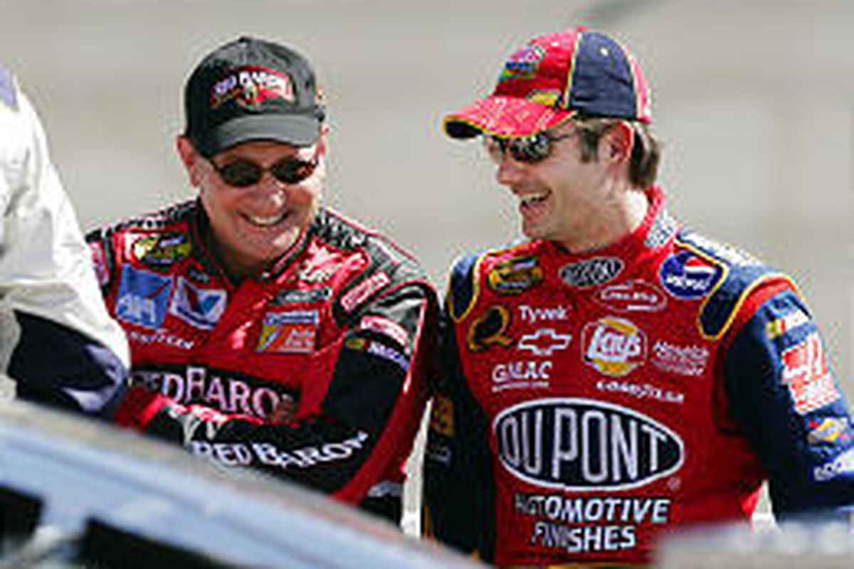 Ken Schrader, left, talks with Jeff Gordon as they wait their turns during Saturday's qualifying for the Sony HD 500.