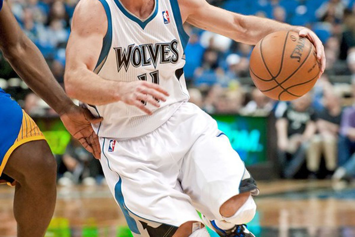 Apr 22, 2012; Minneapolis, MN, USA; Minnesota Timberwolves point guard J.J. Barea (11) drives to the basket against the Golden State Warriors during the third quarter at Target Center. Warriors won 93-88. Mandatory Credit:  Greg Smith-US PRESSWIRE