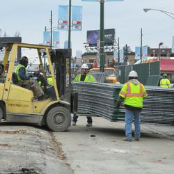 Fences to be installed on the Clark Street side being moved into position