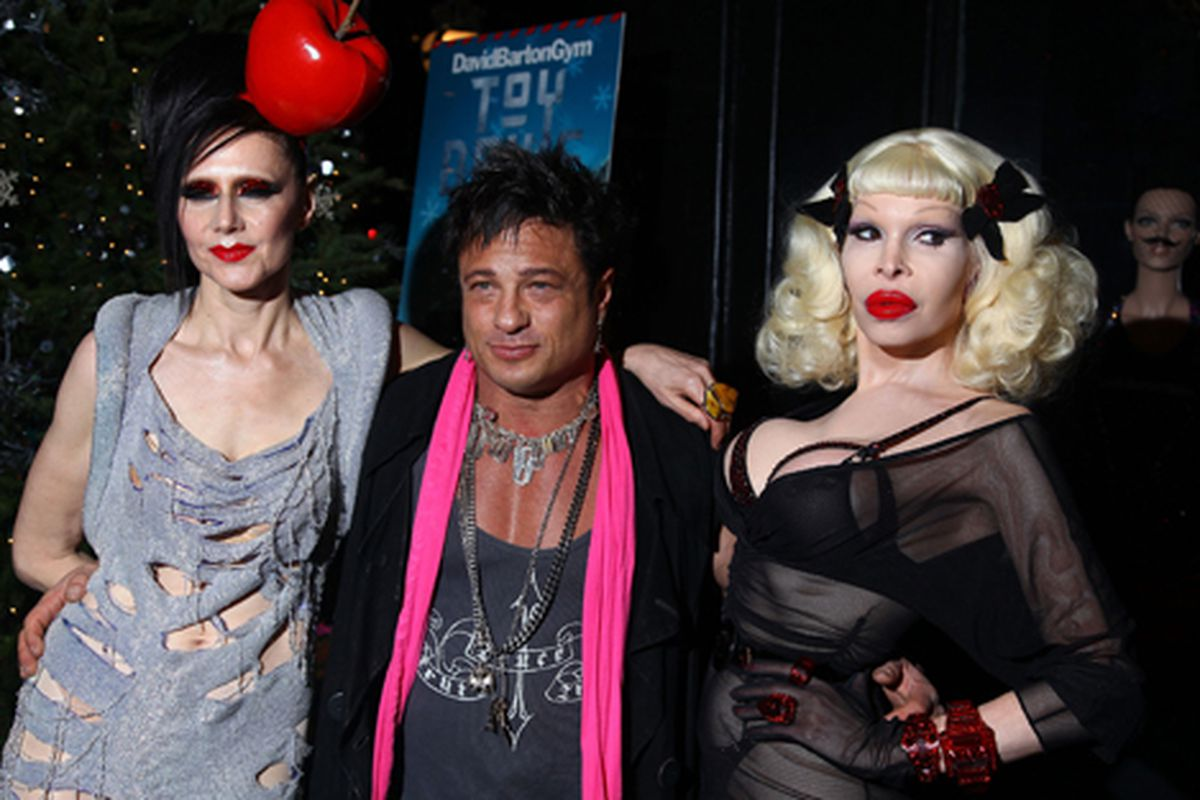 David Barton with wife Susanne Bartsch (left) and Amanda Lepore (right) via Getty Images