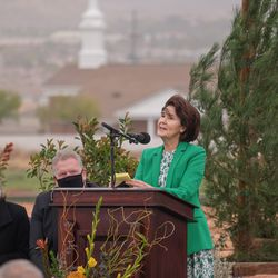 Sister Patricia Holland speaks at the groundbreaking service for the Red Cliffs Utah Temple of The Church of Jesus Christ of Latter-day Saints in St. George, Utah, Saturday, Nov. 7, 2020. Behind Sister Holland are, from left, Sister Debbie Christensen and Utah Area President Craig C. Christensen.