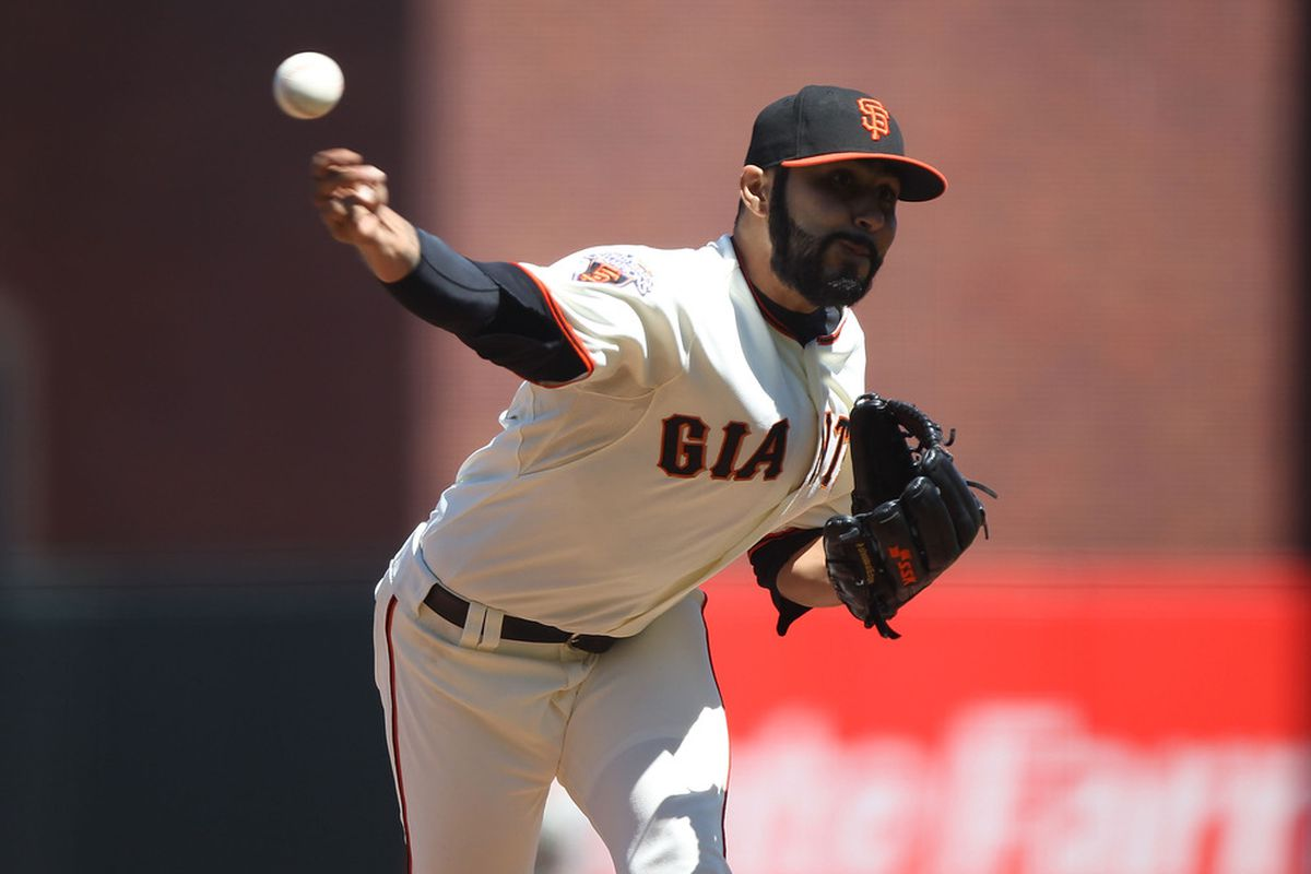 SAN FRANCISCO, CA - JULY 24:  Sergio Romo #54 of the San Francisco Giants pitches against the Milwaukee Brewers at AT&T Park on July 24, 2011 in San Francisco, California.  (Photo by Jed Jacobsohn/Getty Images)