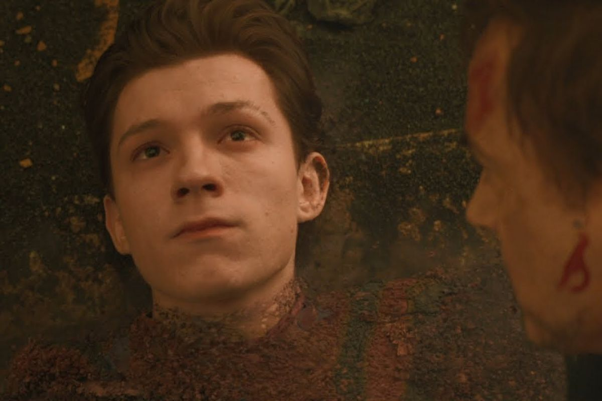 Tom Holland as Spider-Man seen from the neck up.