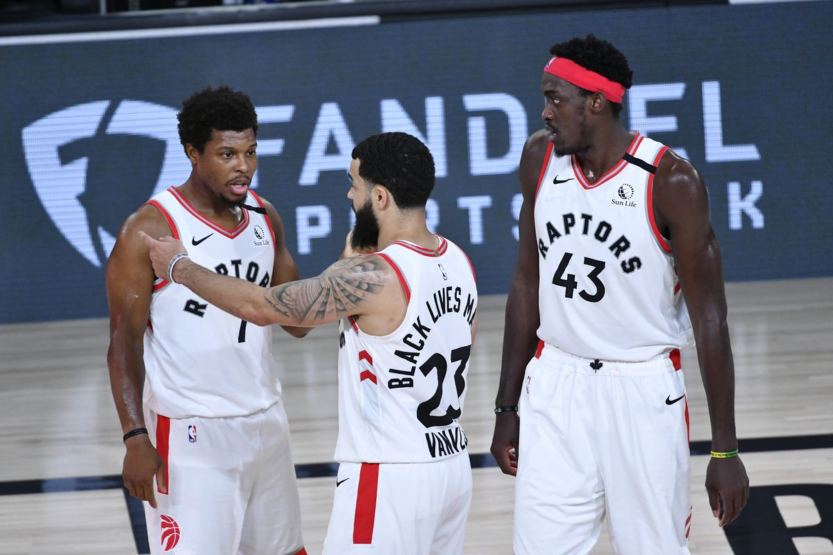 Kyle Lowry #7 and Fred VanVleet #23 of the Toronto Raptors talk during the game against the Boston Celtics during Game Seven of the Eastern Conference Semifinals on September 11, 2020 in Orlando, Florida at AdventHealth Arena.