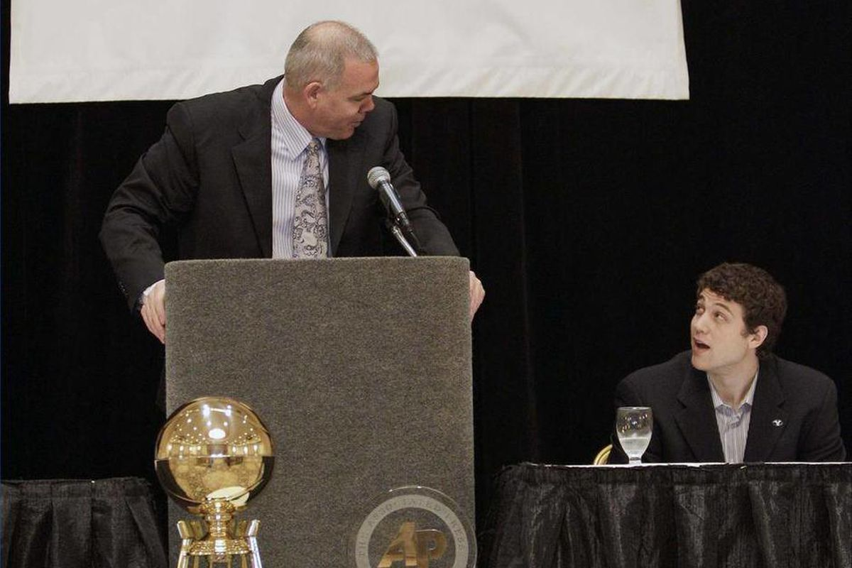 BYU coach Dave Rose talks to BYU's Jimmer Fredette, left, and at a news conference Friday, April 1, 2011, in Houston. Fredette is AP player of the year, while Mike Brey, of Notre Dame, was selected AP coach of the year.