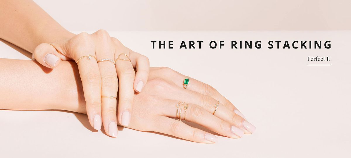 A model's hands wearing several small rings