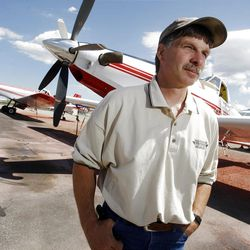Andy Taylor, owner of New Frontier Aviation talks about his job Monday, July 16, 2012 of fighting fires from the air.