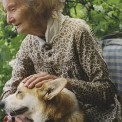 In this undated photo released by the family of Tasha Tudor, children's book illustrator Tasha Tudor is seen holding a dog.The famed author and illustrator died at 92 in 2008.