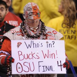 An Ohio State fan celebrates his team's performance