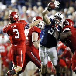 Utah Utes quarterback Jordan Wynn (3) passes over the defense as BYU and Utah play Saturday, Sept. 17, 2011