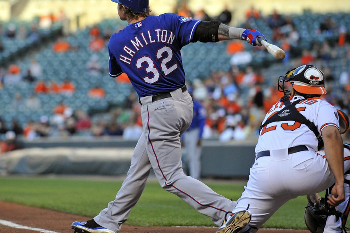 May 10, 2012; Baltimore, MD, USA; Texas Rangers center fielder Josh Hamilton (32) hits a two-run home run in the first inning against the Baltimore Orioles at Oriole Park at Camden Yards. Mandatory Credit: Joy R. Absalon-US PRESSWIRE