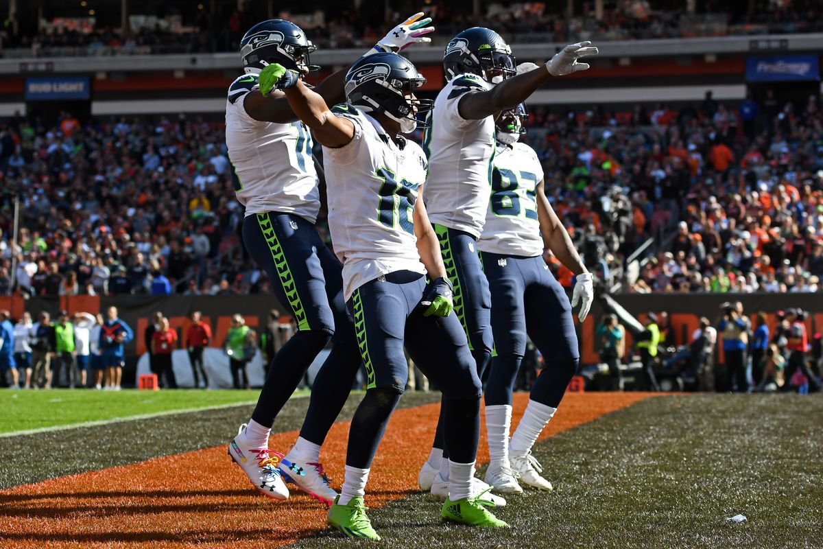 Wide receivers Tyler Lockett #16, DK Metcalf #14, Jaron Brown #18 and David Moore #83 of the Seattle Seahawks celebrate a touchdown by Jaron Brown in the second quarter of a game against the Cleveland Browns on October 13, 2019 at FirstEnergy Stadium in Cleveland, Ohio.