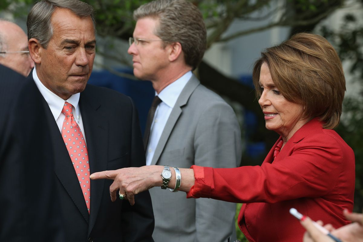 Nancy Pelosi tries to direct Boehner to his right.