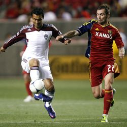 Jonny Steele (right) of Real Salt Lake battles for control of the ball against Kamani Hill of the Colorado Rapids during their MLS match up at Rio Tinto Stadium in Sandy Saturday, April 7, 2012.