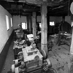 Interior of the Historic Chase Mill is now cluttered with old equipment.