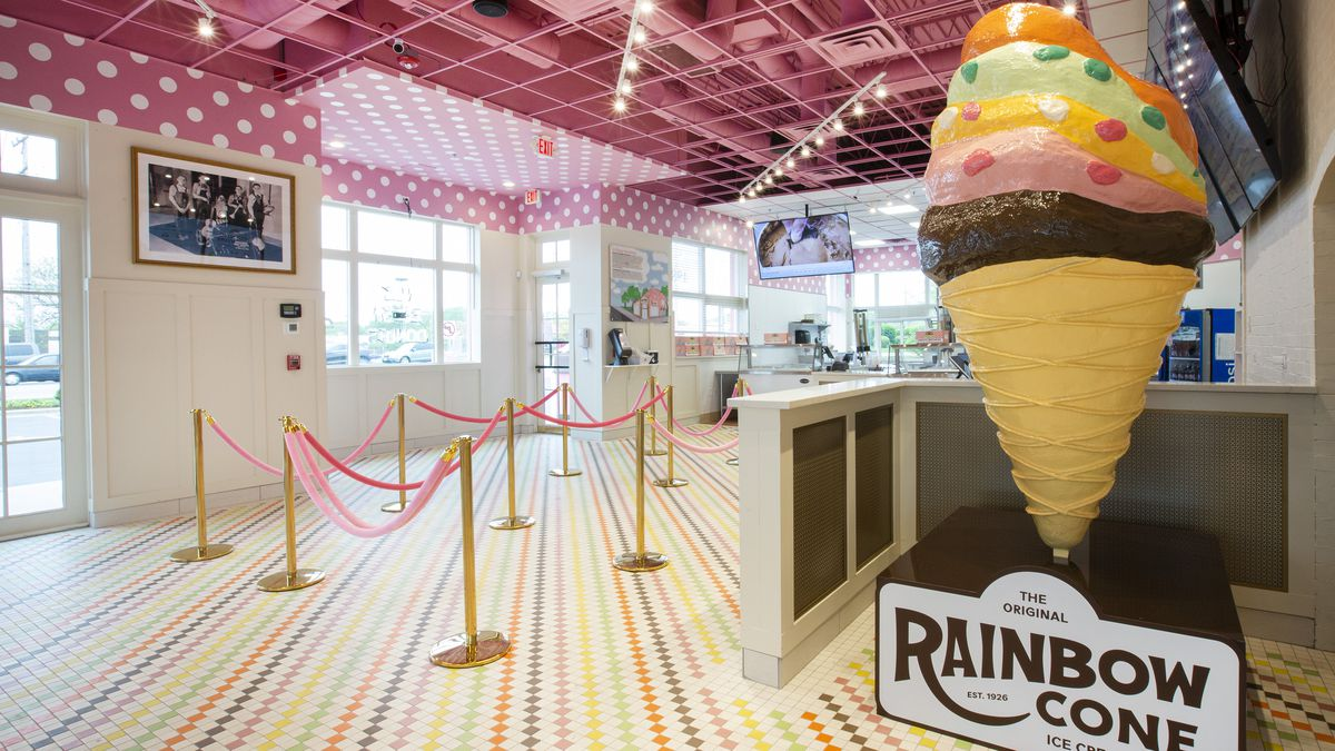A giant fake ice cream cone layers with flavors.