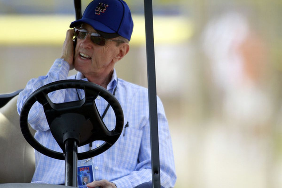 Owner <strong>Fred Wilpon</strong> of the New York Mets talks on the phone during spring training at Tradition Field on February 17 2011 in Port St. Lucie Florida.  (Photo by Marc Serota/Getty Images)