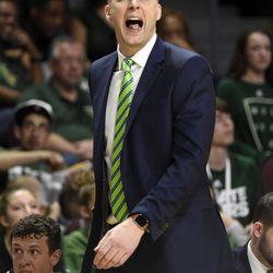 Utah Valley coach Mark Pope calls to his team during the second half of an NCAA college basketball game against Seattle in the first round of the Western Athletic Conference tournament Thursday, March 9, 2017, in Las Vegas. Utah Valley won 65-53.