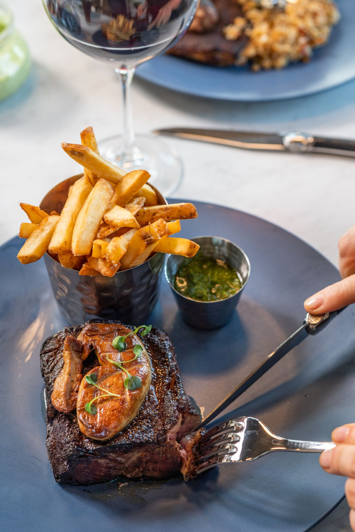 Steak frites with hanger steak, pomme frites, and garlic aioli from Le Vacher