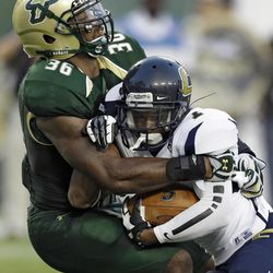 South Florida linebacker Sam Barrington (36) stops Chattanooga wide receiver Ron Moore (7) during the first quarter of an NCAA college football game, Saturday, Sept. 1, 2012, in Tampa, Fla.
