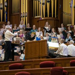 Mack Wilberg, director of the Tabernacle Choir at Temple Square, gets to work as the choir rehearses at the Conference Center in Salt Lake City on Tuesday, Sept. 21, 2021. It was the choir's first rehearsal in more than 18 months.