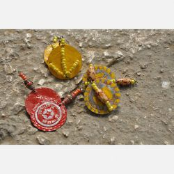 Bottle Cap Earrings - $8.50<br />These flashy earrings are made from flattened and painted metal bottle caps, salvaged from all over Port au Prince. You won't know which of these gorgeously colored earrings you got until you open our package—but if yo
