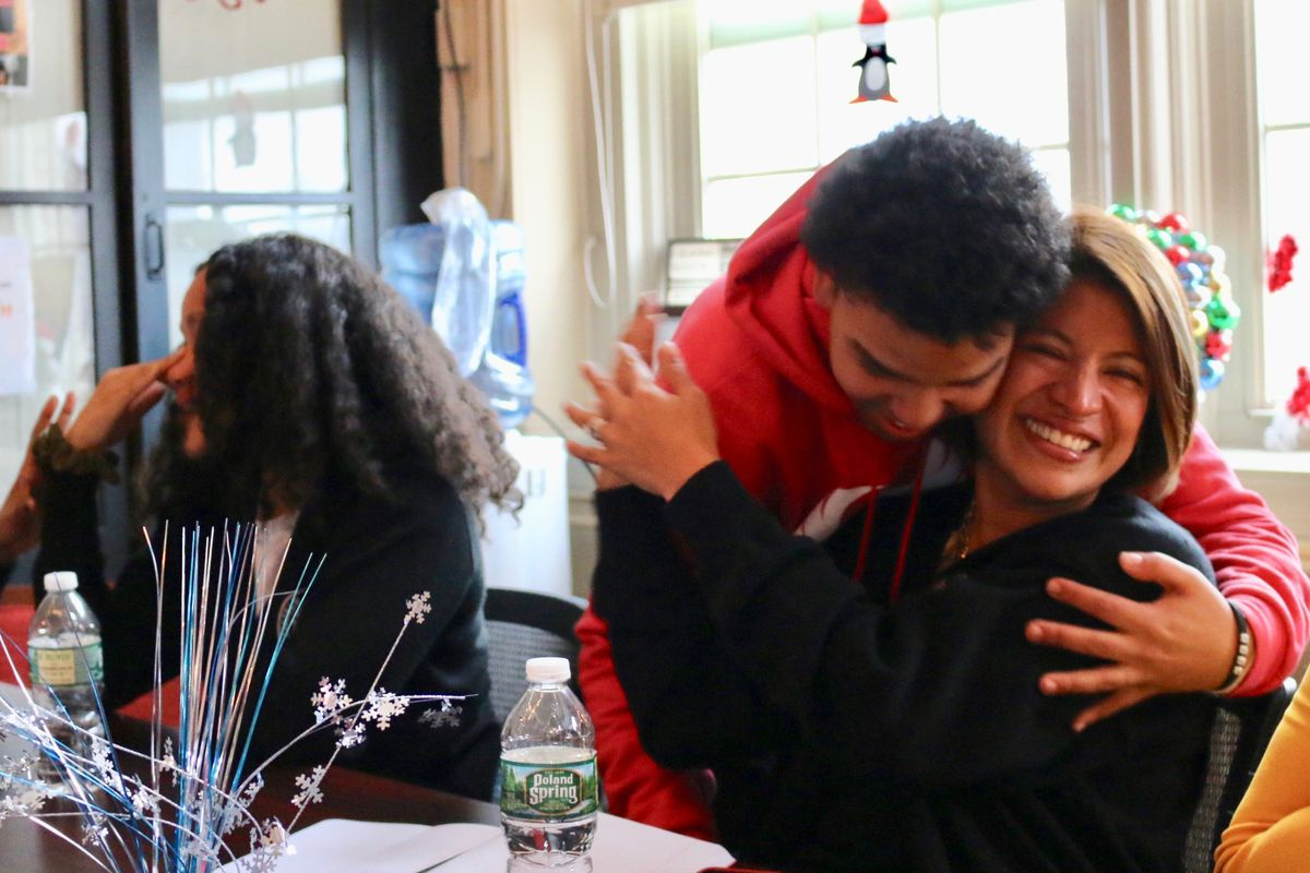Fordham Leadership Academy Principal Fiorella Cabrejos celebrates with student Jasiel Nuñez after learning they are advancing to the next round of a competition to open or overhaul 40 schools.
