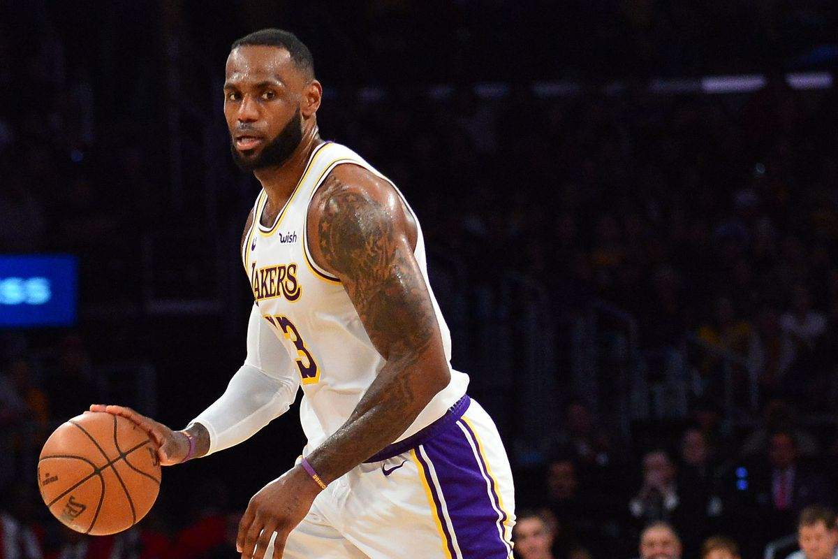 Los Angeles Lakers forward LeBron James moves the ball down court against the Dallas Mavericks during the second half at Staples Center.