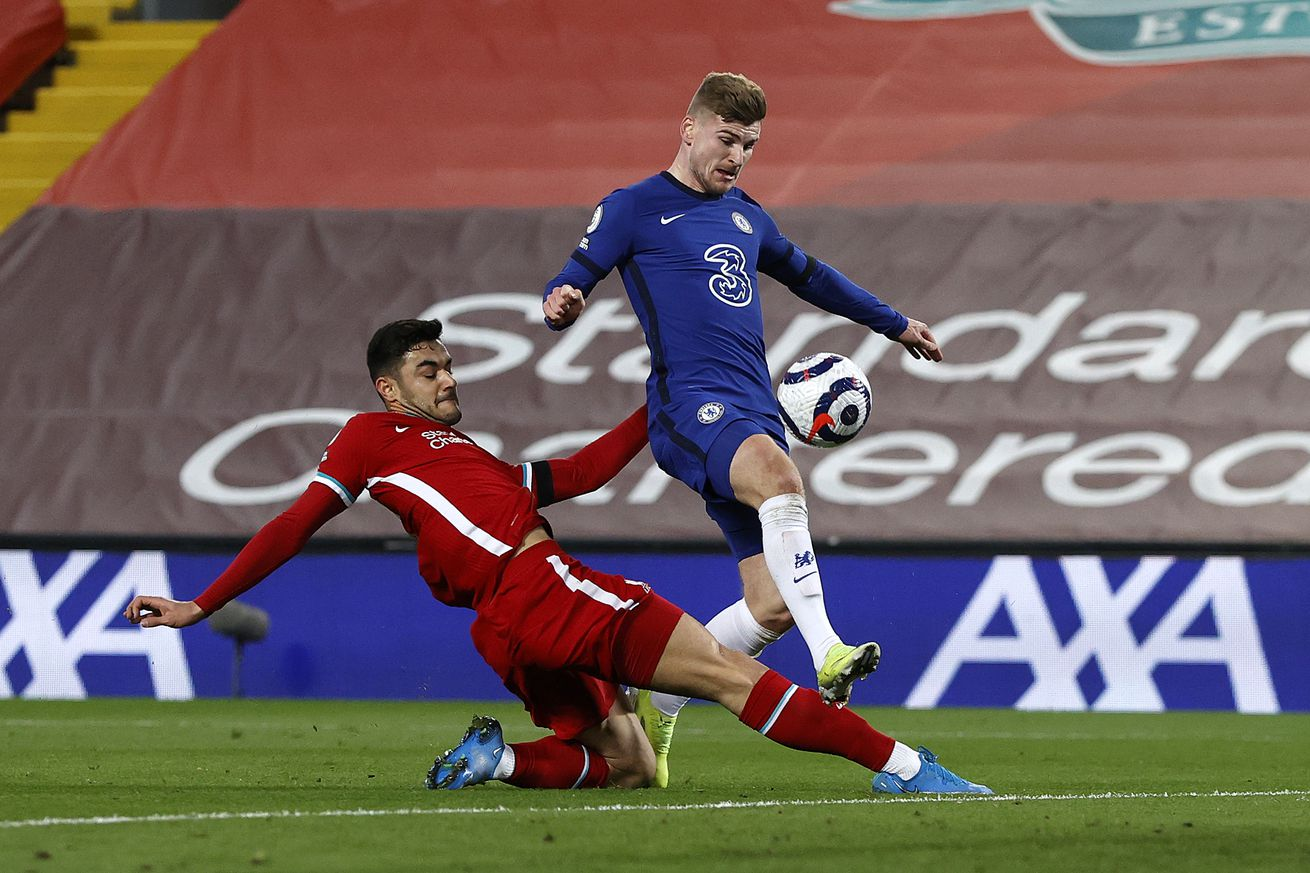 Timo Werner of Chelsea is challenged by Ozan Kabak of Liverpool as he scores a goal which is disallowed for offside following a VAR review during the Premier League match between Liverpool and Chelsea at Anfield on March 04, 2021 in Liverpool, England