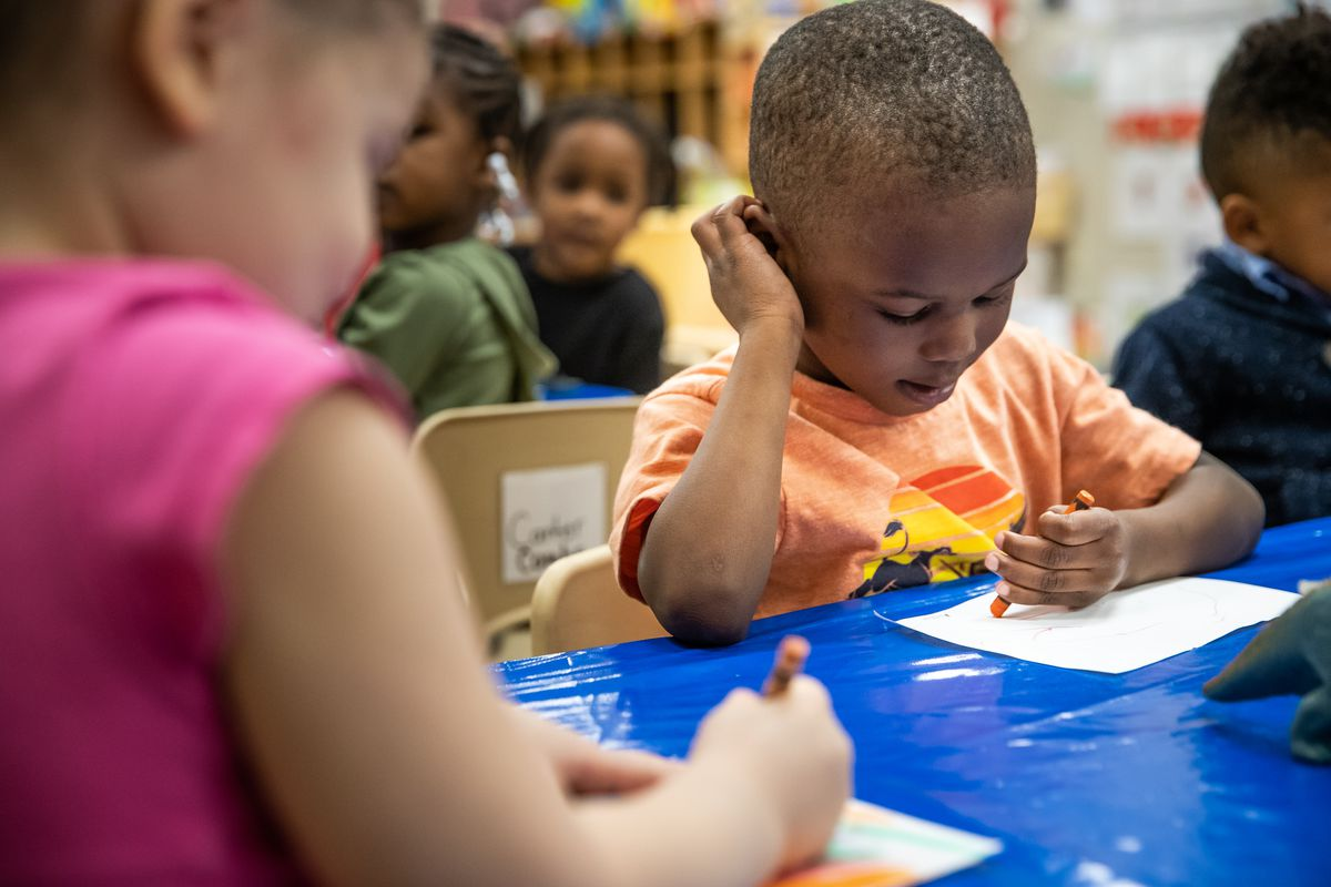 Morghan Hampton, 4, a pre-kindergarten student at Avondale Meadows YMCA Early Learning Center in Indianapolis, draws a picture of his favorite dinosaur during a lesson on Tuesday, April 30, 2019.