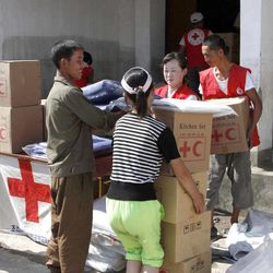 FILE - In this Aug. 4, 2012 file photo, residents collect emergency goods, including kitchen sets and blankets, distributed by North Korean Red Cross officials in the flood-stricken city of Anju in South Phyongan Province, North Korea.  South Korea said North Korea has rejected its offer of food and medical supplies to help flood victims. South Korea on Tuesday, Sept. 11, 2012, proposed providing 10,000 tons of flour, 3 million packages of ramen noodles and medical supplies. Seoul's Unification Ministry said North Korea's Red Cross replied Wednesday, Sept. 12, 2012, it doesn't need the assistance offered.