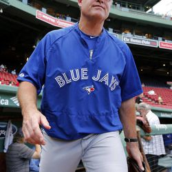 Toronto Blue Jays manager John Farrell comes onto the field during warmups before a baseball game against the Boston Red Sox in Boston, Friday, Sept. 7, 2012.