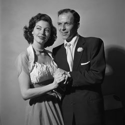 Seen snuggling with Frank Sinatra on their November 7th, 1951 wedding day, Ava Gardner wore a simple halter-neck dress made by Fontana, an Italian fashion house that designed several movie costumes for the film star.