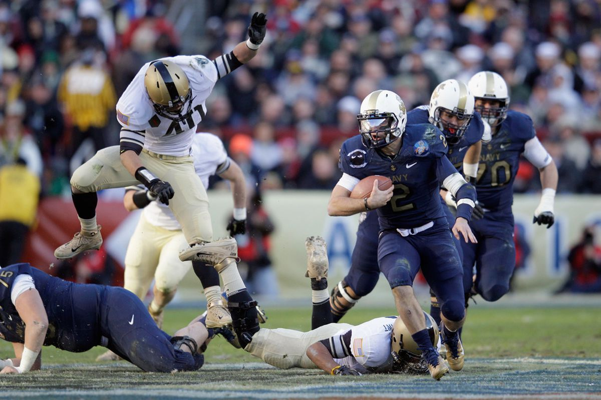 LANDOVER, MD - DECEMBER 10:  Kriss Proctor #2 of the Navy Midshipman rushes the ball against the Army Black Knights during the first half at FedEx Field on December 10, 2011 in Landover, Maryland.  (Photo by Rob Carr/Getty Images)