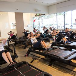 Group one gets their crunches on in the Pilates room.