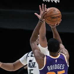 Utah Jazz forward Juwan Morgan (16) attempts to block a shot from Phoenix Suns forward Mikal Bridges (25) during an NBA preseason game at Vivint Smart Home Arena in Salt Lake City on Saturday, Dec. 12, 2020.
