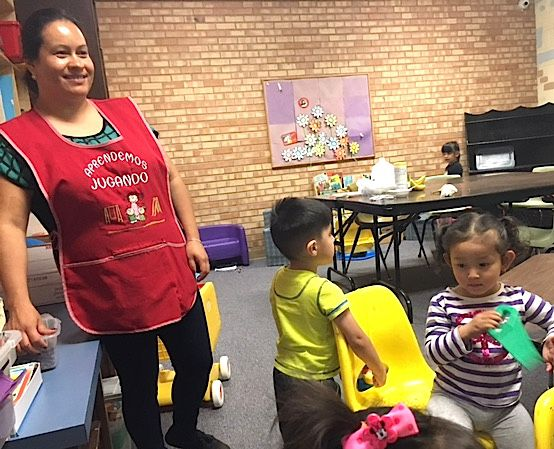 Maria Perez, a PASO graduate, cares for children of current PASO participants.