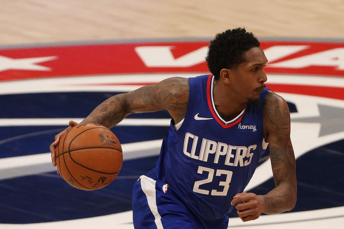 Lou Williams #23 of the Los Angeles Clippers dribbles against the Washington Wizards at Capital One Arena on March 04, 2021 in Washington, DC.