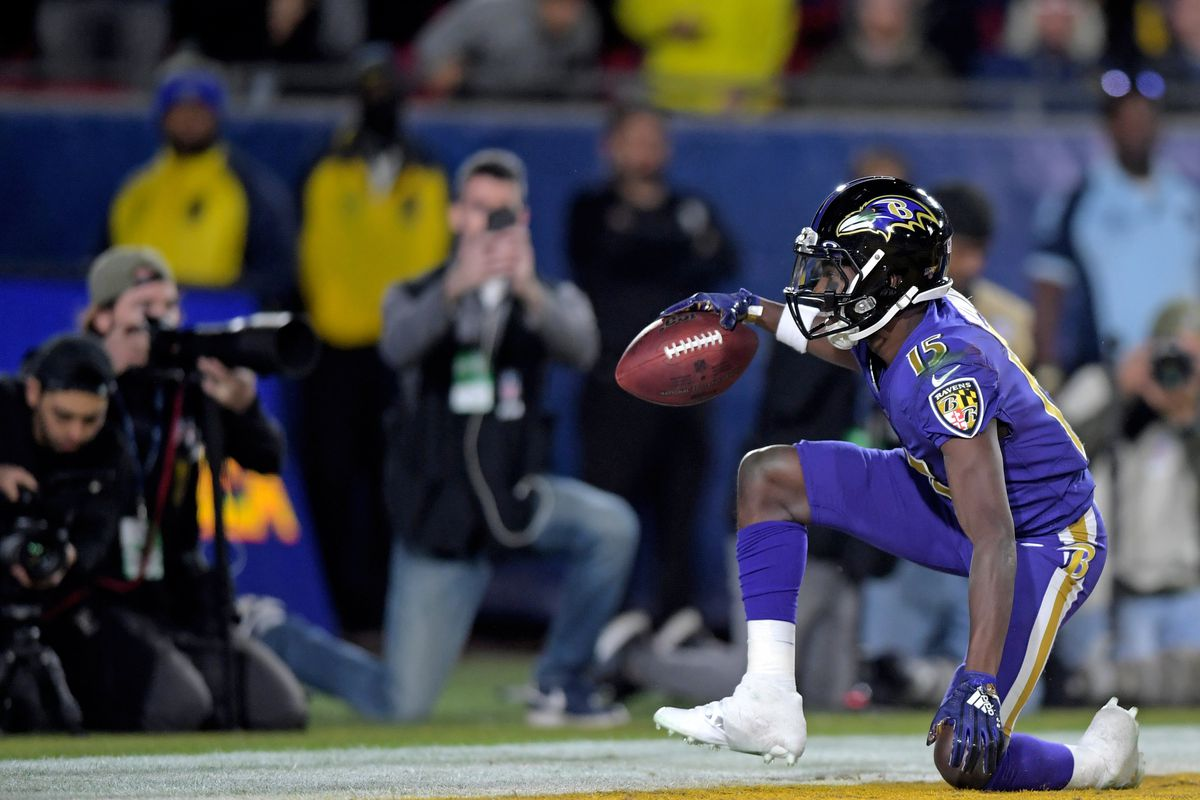 Baltimore Ravens wide receiver Marquise Brown celebrates after scoring a touchdown during the first half against the Los Angeles Rams at Los Angeles Memorial Coliseum.