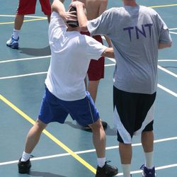 Isn't that cheating? Jazz shooting guard Gordon Hayward (right) holds down his dad while Gordon Scott Hayward tries to post him up during a pick-up game.