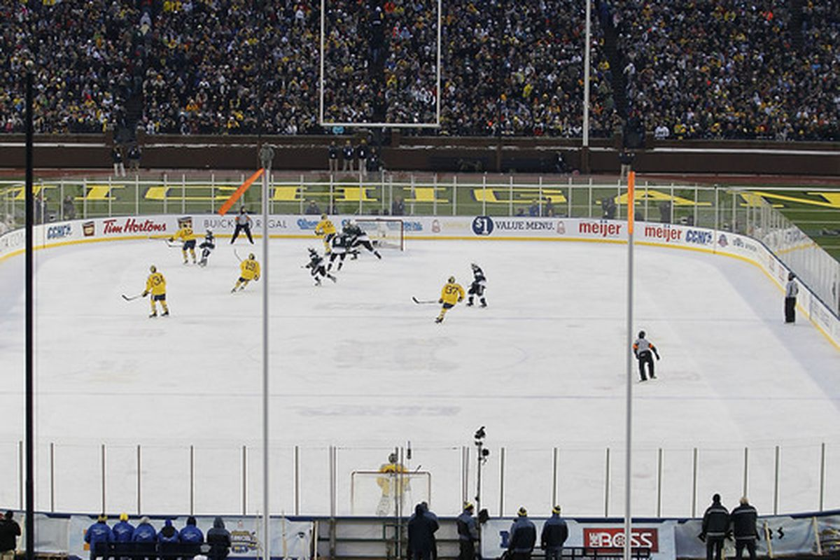 ANN ARBOR MI - DECEMBER 11:  Michigan State Spartans and the Michigan Wolverines battle during second period of the Big Chill game at Michigan Stadium on December 11 2010 in Ann Arbor Michigan.  (Photo by Leon Halip/Getty Images)