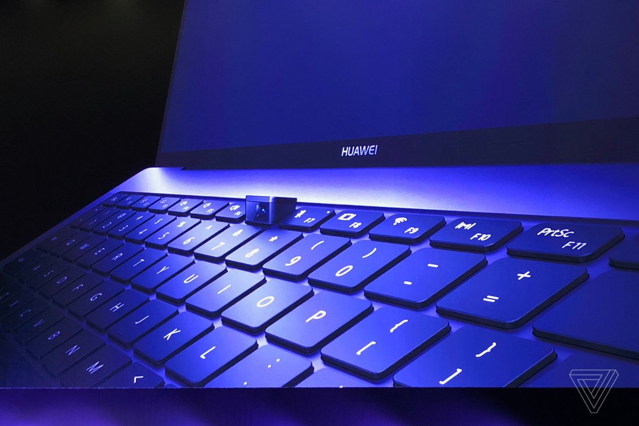 huawei s new laptop has a mechanical pop up webcam in the keyboard